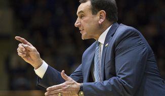 Duke coach Mike Krzyzewski gestures toward his team during the second half of an NCAA college basketball game against Elon in Durham, N.C., Friday, Nov. 10, 2017. Duke defeated Elon 97-68. (AP Photo/Ben McKeown)