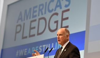 """California Governor Jerry Brown speaks in the U.S. Climate Action Center at the COP 23 Fiji UN Climate Change Conference in Bonn, Germany, Saturday, Nov. 11, 2017. Brown's and Michael Bloomberg's """"America's Pledge"""" campaign works to compile and tally the climate actions of states, cities, colleges, businesses, and other local actors across the entire U.S. economy. (AP Photo/Martin Meissner)"""