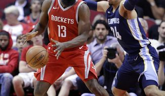 Houston Rockets guard James Harden (13) regains control of the ball under pressure from Memphis Grizzlies forward Dillon Brooks (24) during the first half of an NBA basketball game Saturday, Nov. 11, 2017, in Houston. (AP Photo/Michael Wyke)