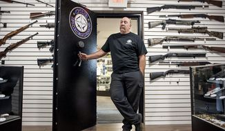 Chris Endres, co-owner of CTR Firearms, speaks about his store's vault used to display guns and keep them secure Tuesday, Oct. 31, 2017, at CTR Firearms in Janesville, Wis. (Angela Major/The Janesville Gazette via AP)
