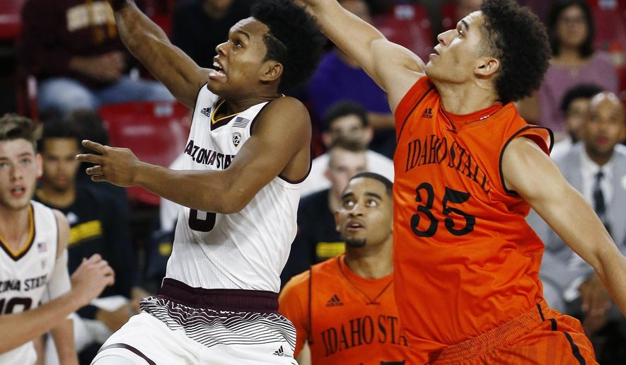 Arizona State guard Tra Holder, left, drives past Idaho State forward Kyle Ingram (35) and guard Brandon Boyd (15) during the second half of an NCAA basketball game Friday, Nov. 10, 2017, in Tempe, Ariz. (AP Photo/Ross D. Franklin)