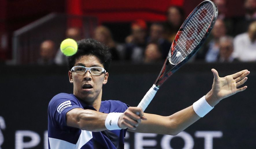 Hyeon Chung, of South Korea, returns the ball to Andrey Rublev, of Russia, during the ATP Next Gen tennis tournament final, in Milan, Italy, Saturday, Nov. 11, 2017. (AP Photo/Antonio Calanni)