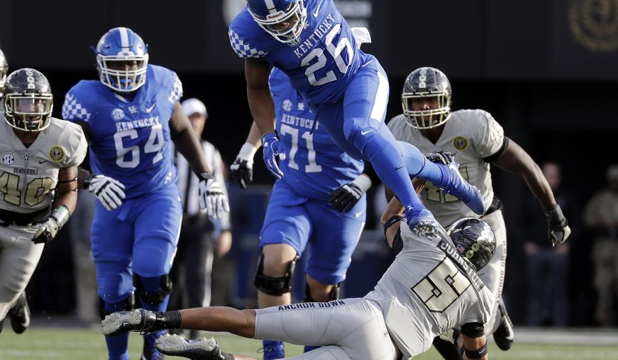 Kentucky running back Benny Snell Jr. (26) leaps over Vanderbilt safety LaDarius Wiley (5) in the first half of an NCAA college football game Saturday, Nov. 11, 2017, in Nashville, Tenn. (AP Photo/Mark Humphrey)