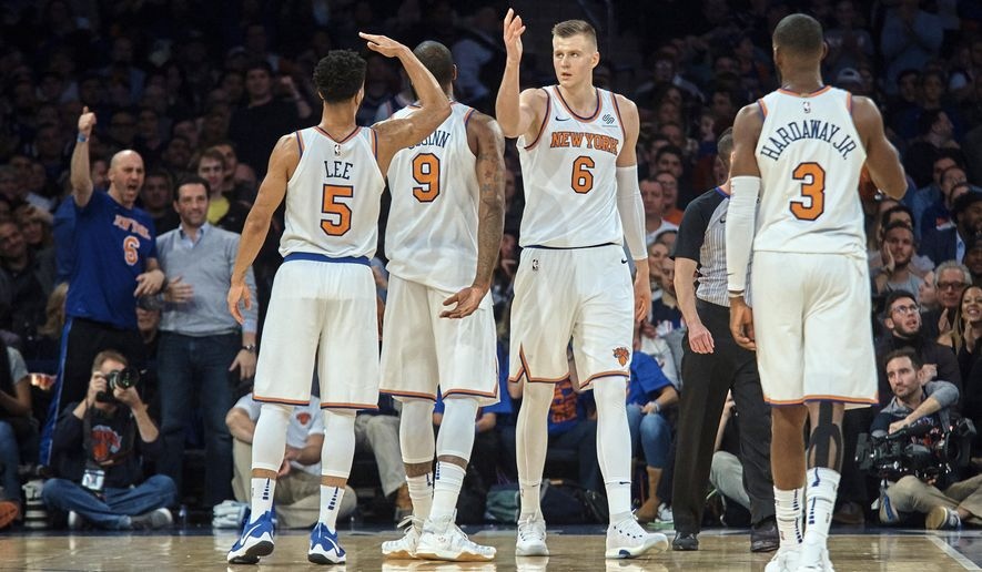 New York Knicks' Kristaps Porzingis, center, celebrates with team mates during the first half of a NBA basketball game against Sacramento Kings at Madison Square Garden in New York, Saturday, Nov. 11, 2017. (AP Photo/Andres Kudacki)