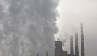 Smoke and steam billow from the chimneys of the Kosovo A power plant, near Obilic, Kosovo, Friday, Nov. 10, 2017. The COP 23 Fiji UN Climate Change Conference is taking place in Bonn, Germany. The two-week meeting that started Monday is the first major conference on climate change since President Donald Trump said that the U.S. will pull out of the Paris accord unless his administration can secure a better deal. (AP Photo/Visar Kryeziu)