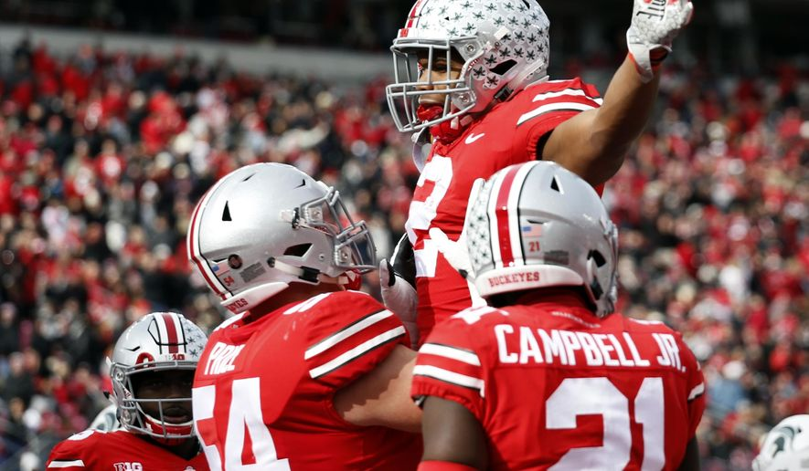 Ohio State running back J.K. Dobbins celebrates his touchdown against Michigan State during the first half of an NCAA college football game Saturday, Nov. 11, 2017, in Columbus, Ohio. (AP Photo/Jay LaPrete)