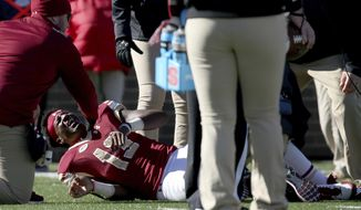 Boston College quarterback Anthony Brown (13) yells out after getting injured during the first half of an NCAA college football game against North Carolina Statem Saturday, Nov. 11, 2017, in Boston. (AP Photo/Mary Schwalm)
