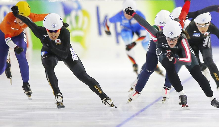 Japan's Ayano Sato, left, sprints for the victory with Canada's Ivanie Blondin, right, during the final of the women's mass start race of the Speedskating World Cup at the Thialf ice rink in Heerenveen, Netherlands, Saturday, Nov. 11, 2017. (AP Photo/Peter Dejong)