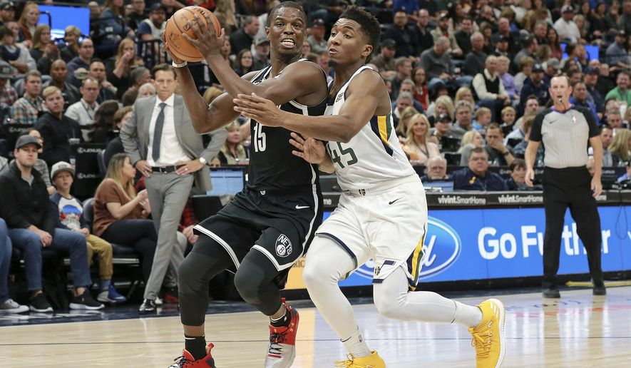 Brooklyn Nets guard Isaiah Whitehead (15) is fouled by Utah Jazz guard Donovan Mitchell (45) while driving to the basket during the second quarter of NBA basketball game Saturday, Nov. 11, 2017, in Salt Lake City. (AP Photo/Chris Nicoll)