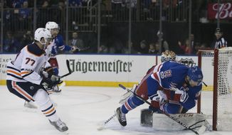 New York Rangers right wing Rick Nash (61) scores on Edmonton Oilers goalie Cam Talbot during the second period of an NHL hockey game, Saturday, Nov. 11, 2017 in New York. (AP Photo/Kevin Hagen)
