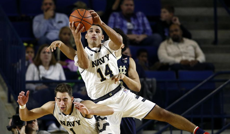 Navy guard Bryce Dulin grabs a rebound over teammate Tom Lacey, bottom left, and Pittsburgh forward Kene Chukwuka during the second half of an NCAA college basketball game at the Veterans Classic tournament in Annapolis, Md., Friday, Nov. 10, 2017. Navy won 71-62. (AP Photo/Patrick Semansky) **FILE**