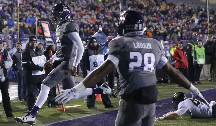 Northwestern quarterback Clayton Thorson, left, scores a touchdown during the first half of an NCAA college football game against Purdue, Saturday, Nov. 11, 2017, in Evanston, Ill. (AP Photo/Nam Y. Huh)