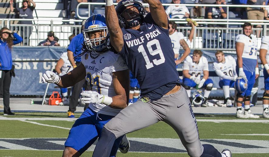Nevada receiver Wyatt Demps (19) makes a catch over San Jose State' Andre Chachere in the first half of an NCAA college football game in Reno, Nev. Saturday, Nov. 11, 2017. (AP Photo/Tom R. Smedes)