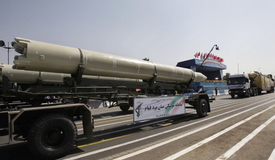 FILE - In this Friday, Sept. 21, 2012 file photo, a Qiam missile is displayed by Iran's Revolutionary Guard during a military parade commemorating the start of the Iraq-Iran war in front of the mausoleum of the late revolutionary founder Ayatollah Khomeini just outside Tehran, Iran. Saudi Arabia and the U.S. now accuse Iran of supplying ballistic missiles to Shiite rebels in Yemen, including this model. (AP Photo/Vahid Salemi, File)