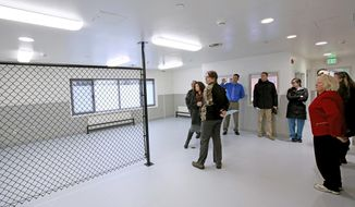 In this Monday, Nov. 6, 2017 photo, a group of attendees take a tour of the sobering center facility during the Tanana Chiefs Conference Sobering Center open house in Fairbanks, Alaska. The center will move to a 24-hour per day, seven day per week operation when more equipment and staff arrive. (Eric Engman /Fairbanks Daily News-Miner via AP)