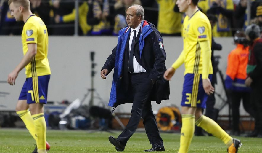 Italy coach Gian Piero Ventura walks off the pitch at the end of the World Cup qualifying play-off first leg soccer match between Sweden and Italy, at the Friends Arena in Stockholm, Friday, Nov. 10, 2017. Sweden won 1-0. (AP Photo/Frank Augstein)