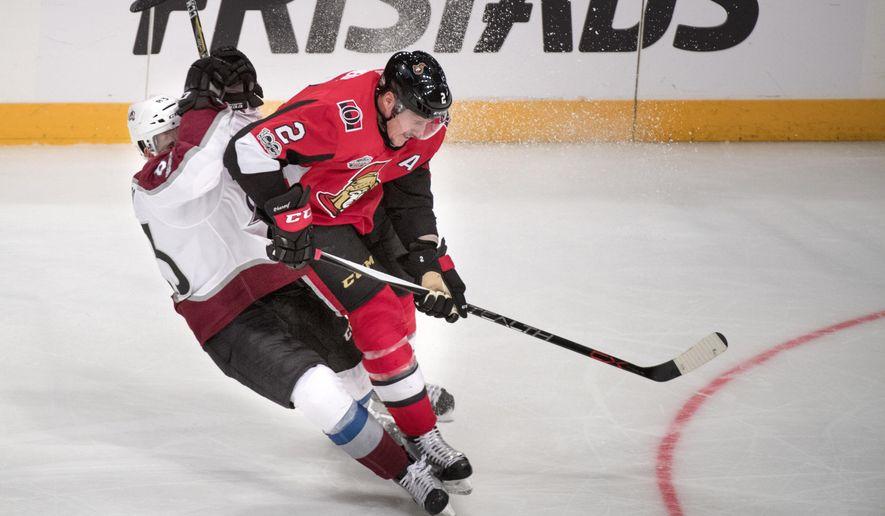 Colorado Avalanche's Matt Nieto and Ottawa Senators' Dion Phaneuf, right, in action during the NHL Global Series hockey game between Ottawa Senators and Colorado Avalanche at Ericsson Globe in Stockholm, Saturday Nov. 11, 2017. ( Jessica Gow/TT via AP)
