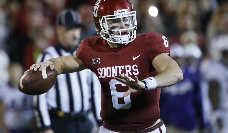 Oklahoma quarterback Baker Mayfield (6) throws in the second quarter of an NCAA college football game against TCU in Norman, Okla., Saturday, Nov. 11, 2017. (AP Photo/Sue Ogrocki)