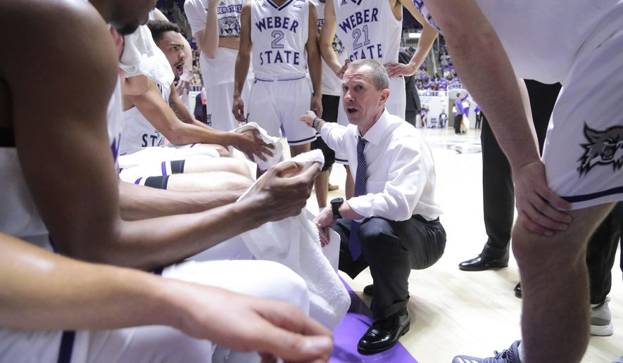 Weber State coach Randy Rahe talks to his players during a second-half timeout in an NCAA college basketball game against Utah State on Friday, Nov. 10, 2017, in Ogden, Utah. (Matt Herp/Standard-Examiner via AP)