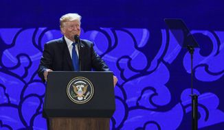 US President Donald Trump speaks on the final day of the APEC CEO Summit, part of the broader Asia-Pacific Economic Cooperation (APEC) leaders' summit, in the central Vietnamese city of Danang on  Friday Nov. 10, 2017. World leaders and senior business figures are gathering in the Vietnamese city of Danang this week for the annual 21-member APEC summit. (Anthony Wallace, Pool via AP)