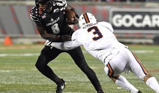 Virginia safety Quin Blanding (3) attempts to wrap up Louisville quarterback Lamar Jackson (8) during the second half of an NCAA college football game, Saturday, Nov. 11, 2017, in Louisville, Ky. Louisville won 38-21. (AP Photo/Timothy D. Easley)