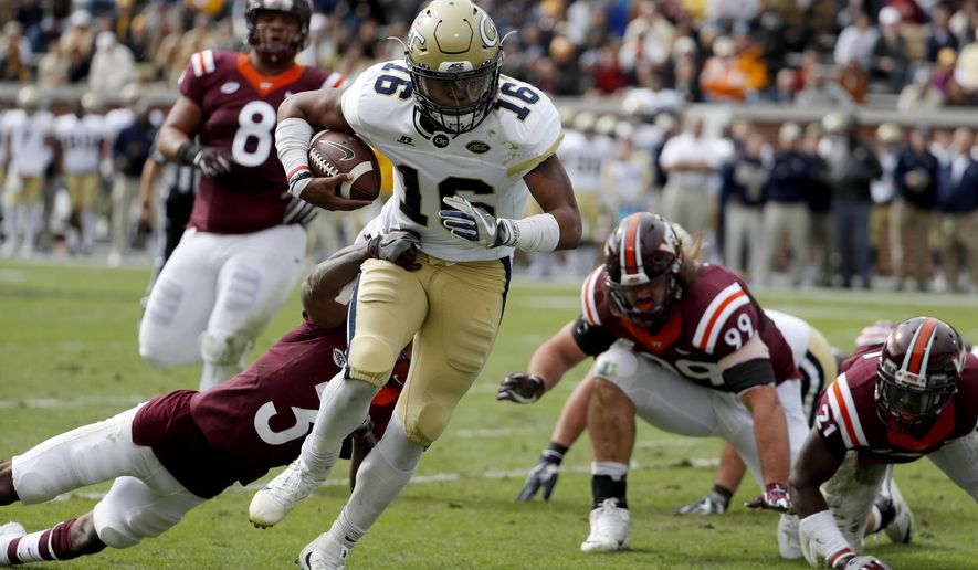 Georgia Tech quarterback TaQuon Marshall runs the ball past the reach of Virginia Tech's Greg Stroman to score a touchdown in the first quarter of an NCAA college football game in Atlanta, Saturday, Nov. 11, 2017. (AP Photo/David Goldman)