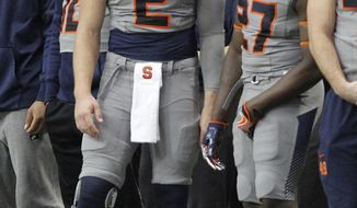 Syracuse's Eric Dungey, left, talks with teammate Nadarius Fagan, right, on the sidelines in the second quarter of an NCAA college football game in Syracuse, N.Y., Saturday, Nov. 11, 2017. Dungey is injured and not playing in the game. (AP Photo/Nick Lisi)