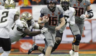 Syracuse's Zack Mahoney, right, runs and is tackled by Wake Forest's Willie Yarbary, left, in the third quarter of an NCAA college football game in Syracuse, N.Y., Saturday, Nov. 11, 2017. (AP Photo/Nick Lisi)
