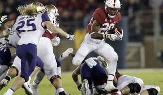 Stanford 's Bryce Love (20) runs against Washington during the first half of an NCAA college football game Friday, Nov. 10, 2017, in Stanford, Calif. (AP Photo/Marcio Jose Sanchez)