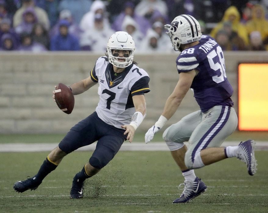 West Virginia quarterback Will Grier (7) runs under pressure from Kansas State linebacker Trent Tanking (58) during the first half of an NCAA college football game, Saturday, Nov. 11, 2017, in Manhattan, Kan. (AP Photo/Charlie Riedel)