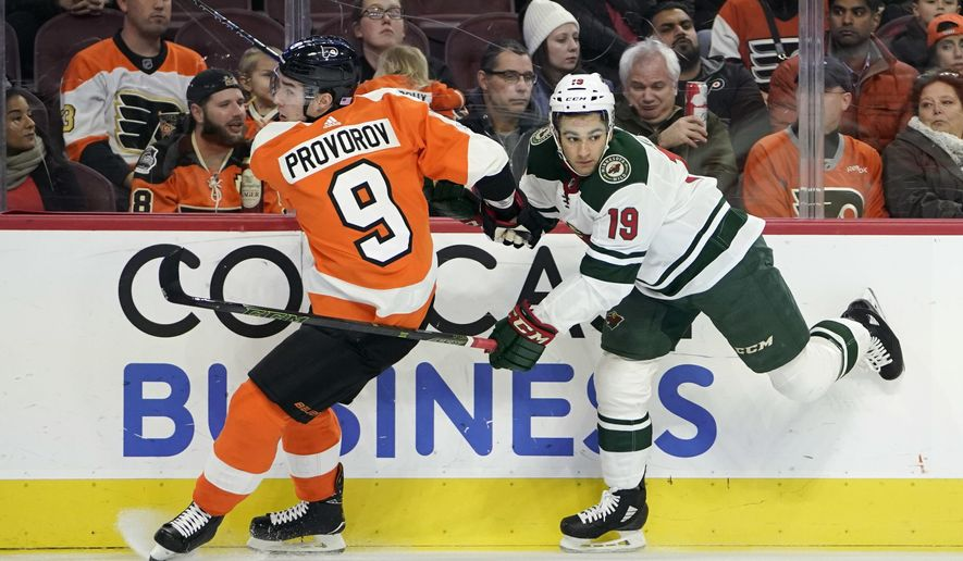 Philadelphia Flyers' Ivan Provorov, left, collides with Minnesota Wild's Luke Kunin during the first period of an NHL hockey game, Saturday, Nov. 11, 2017, in Philadelphia. (AP Photo/Matt Slocum)