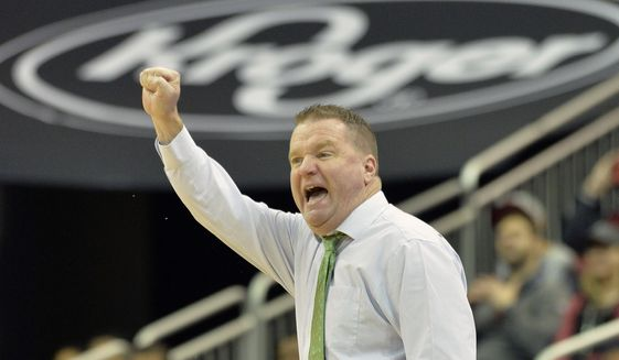 George Mason head coach Dave Paulsen sends in a play to his team during the first half of an NCAA college basketball game against Louisville, Sunday, Nov. 12, 2017, in Louisville, Ky. (AP Photo/Timothy D. Easley) **FILE**
