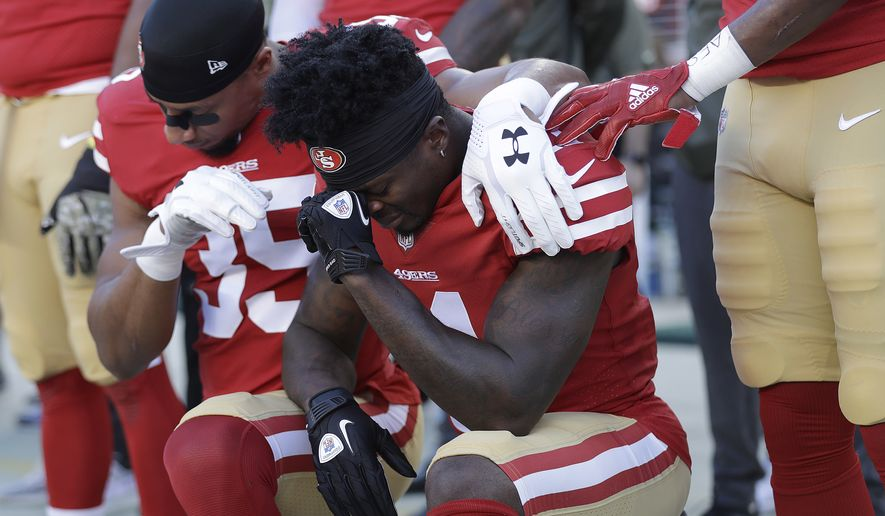 San Francisco 49ers safety Eric Reid, left, and wide receiver Marquise Goodwin kneel during the performance of the national anthem before an NFL football game against the New York Giants in Santa Clara, Calif., Sunday, Nov. 12, 2017. (AP Photo/Marcio Jose Sanchez)
