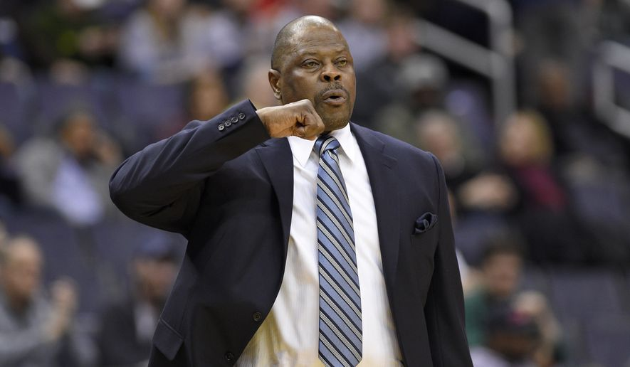 Georgetown head coach Patrick Ewing gestures during the first half of an NCAA college basketball game against Jacksonville, Sunday, Nov. 12, 2017, in Washington. (AP Photo/Nick Wass) **FILE**