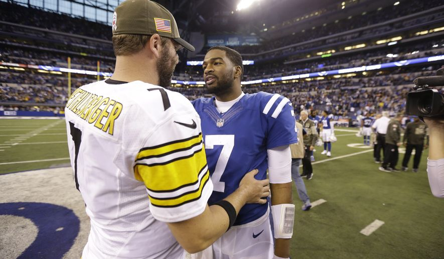 Indianapolis Colts quarterback Jacoby Brissett (7) greets Pittsburgh Steelers quarterback Ben Roethlisberger (7) following an NFL football game in Indianapolis, Sunday, Nov. 12, 2017. The Steelers defeated the Colts 20-17. (AP Photo/AJ Mast)