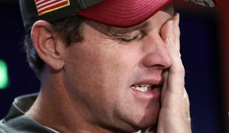 Washington Redskins head coach Jay Gruden rubs his face at a press conference after an NFL football game against the Minnesota Vikings in Landover, Md., Sunday, Nov. 12, 2017. The Vikings defeated the Redskins 38-30. (AP Photo/Alex Brandon)