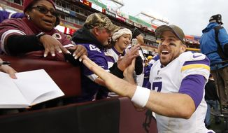 Minnesota Vikings quarterback Case Keenum (7) greets fans after an NFL football game against the Washington Redskins in Landover, Md., Sunday, Nov. 12, 2017. The Vikings defeated the Redskins 38-30. (AP Photo/Alex Brandon)