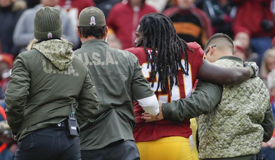 Washington Redskins running back Rob Kelley (20) is helped off the field after an injury during the first half of an NFL football game against the Minnesota Vikings in Landover, Md., Sunday, Nov. 12, 2017. (AP Photo/Alex Brandon)