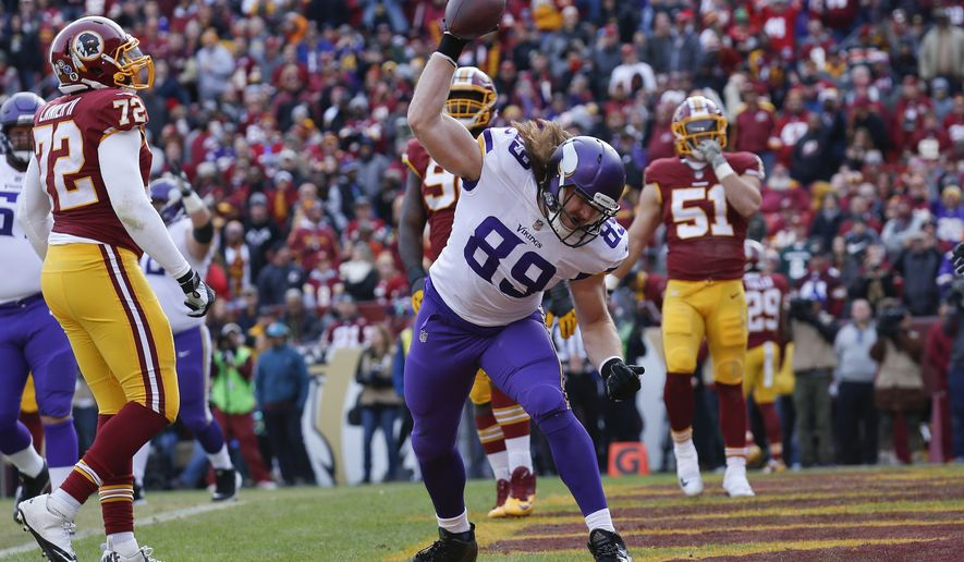 Minnesota Vikings tight end David Morgan (89) celebrates his touchdown during the first half of an NFL football game against the Washington Redskins in Landover, Md., Sunday, Nov. 12, 2017. (AP Photo/Alex Brandon)