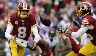 Washington Redskins quarterback Kirk Cousins (8) pitches the ball to running back Chris Thompson (25) during an NFL football game against the Minnesota Vikings, Sunday, Nov. 12, 2017, in Landover, Md. (AP Photo/Mark Tenally)
