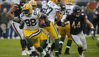 Green Bay Packers running back Ty Montgomery (88) breaks away from the Chicago Bears defense for a touchdown during the first half of an NFL football game, Sunday, Nov. 12, 2017, in Chicago. (AP Photo/Charles Rex Arbogast)