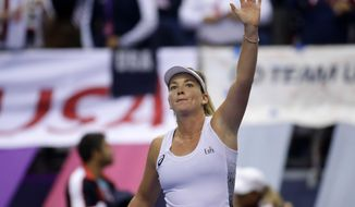 CoCo Vandeweghe of the United States celebrates after defeating Aryna Sabalenka of Belarus during the Fed Cup final match between Belarus and USA, in Minsk, Belarus, Sunday, Nov.12, 2017. (AP Photo/Sergei Grits)