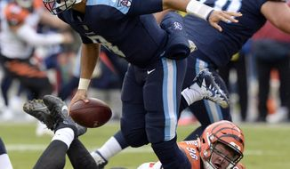 Tennessee Titans quarterback Marcus Mariota (8) gets past Cincinnati Bengals defensive tackle Ryan Glasgow (98) in the second half of an NFL football game Sunday, Nov. 12, 2017, in Nashville, Tenn. (AP Photo/Mark Zaleski)