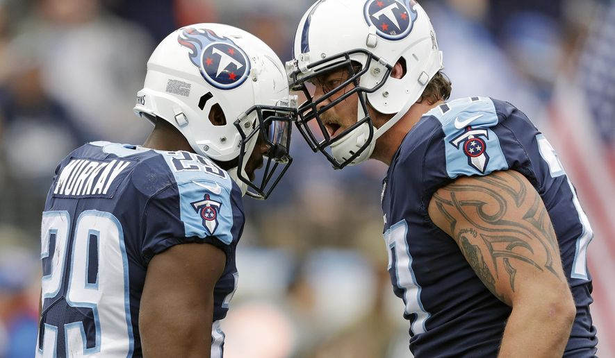 Tennessee Titans running back DeMarco Murray (29) celebrates with tackle Taylor Lewan, right, after Murray scored a touchdown on a 2-yard run against the Cincinnati Bengals in the first half of an NFL football game Sunday, Nov. 12, 2017, in Nashville, Tenn. (AP Photo/Mark Zaleski)