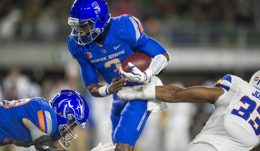 Boise State quarterback Montell Cozart is sacked by Colorado State linebacker Emmanuel Jones during the first quarter of an NCAA college football game Saturday, Nov. 11, 2017, in Fort Collins, Colo. (Timothy Hurst/The Coloradoan via AP)