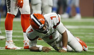 Cleveland Browns quarterback DeShone Kizer reacts after a hit during the second half of an NFL football game against the Detroit Lions, Sunday, Nov. 12, 2017, in Detroit. (AP Photo/Rick Osentoski)
