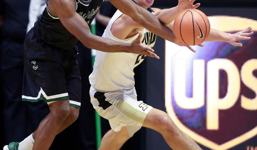 Chicago State guard Glen Burns, left, and Purdue forward Grady Eifert, right, fight to control the ball in the second half of an NCAA college basketball game, Sunday, Nov. 12, 2017, in West Lafayette, Ind. Purdue won 111-42. (AP Photo/R Brent Smith)
