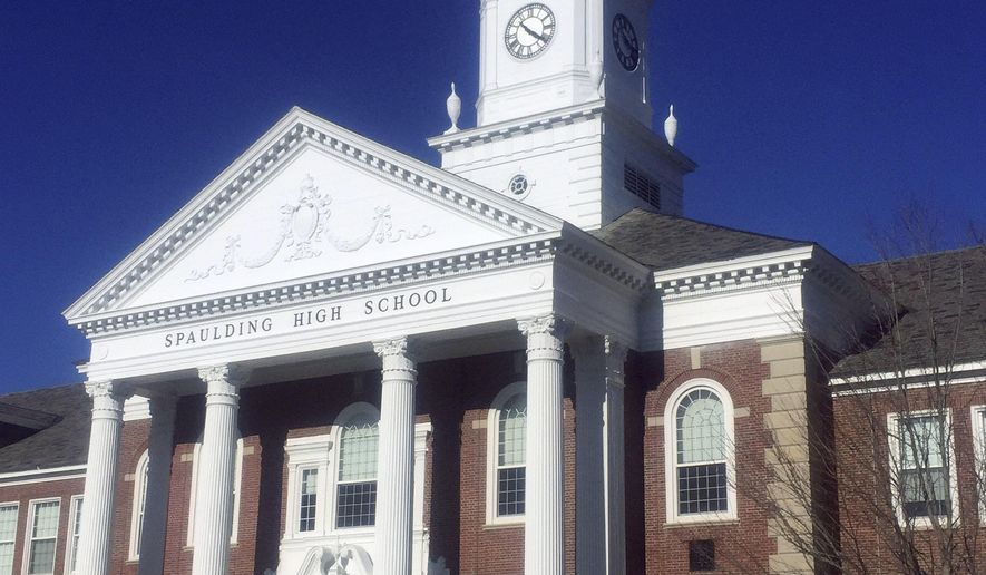 This Sept. 21, 2017 photo provided by David Totty shows tower clock atop Spaulding High School in Rochester, N.H. After it quit working during the summer, Paul Dumont, a retired county commissioner with a background in electronics, came to the rescue and restored the tower clock again, nearly 20 years after he first restored it in 1999. (David Totty via AP)