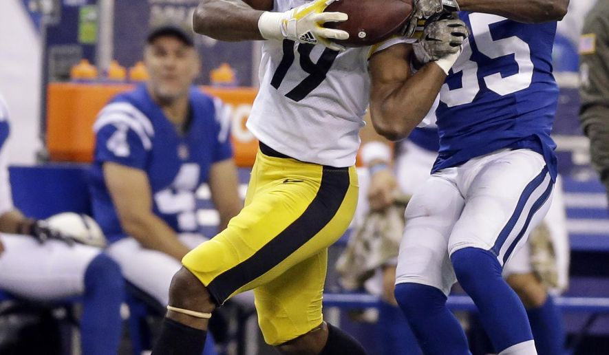 CORRECTS BY REMOVING REFERENCE TO TOUCHDOWN AS THERE WAS NONE ON THE PLAY- Pittsburgh Steelers wide receiver JuJu Smith-Schuster (19) makes a catch in front of Indianapolis Colts cornerback Pierre Desir (35) during the second half of an NFL football game in Indianapolis, Sunday, Nov. 12, 2017. (AP Photo/AJ Mast)