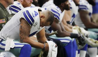 Dallas Cowboys quarterback Zac Dysert (4) sits on the bench during the second half of an NFL football game against the Atlanta Falcons, Sunday, Nov. 12, 2017, in Atlanta. (AP Photo/David Goldman)